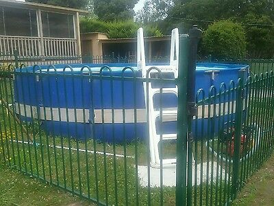 above ground swimming pool with filter and fence