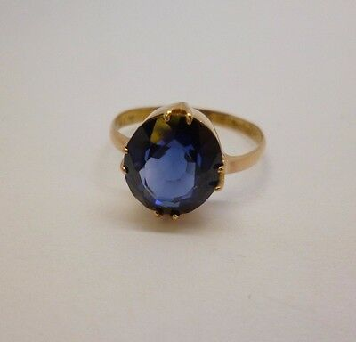 18ct rose gold oval sapphire dress ring with a plain shank size P unhallmarked