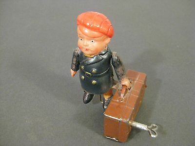 "VINTAGE JAPAN TRAVEL BOY w/ SUITCASE TIN / CELLULOID WIND UP TOY 4 1/4"" tall"