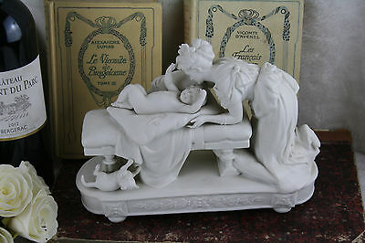 Antique French bisque Victorian romantic group child bed cat lady figurines