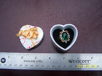 HGE Lindy gold ring green stone heart box with bow