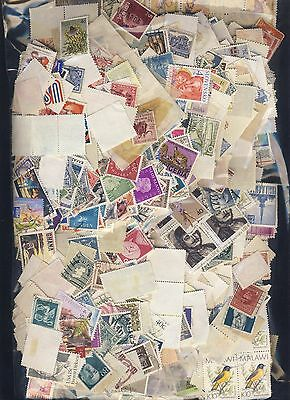 250 grams of unpicked off paper all world stamps (no GB) ex chairty kiloware