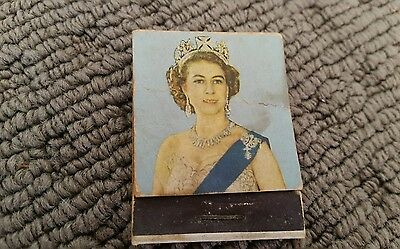 Queen Elizabeth II and Prince Charles match books
