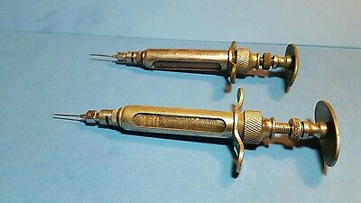 Lot of 2 - Antique Veterinary Syringes O.M. Franklin Serum Co. No. 6F