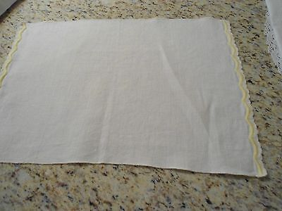 Set of 4 cream linen placemats with scalloped yellow machine embroidery side edg