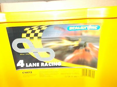 Vintage Scalextric C1072 4-Lane slot car racing set, never upacked or used.