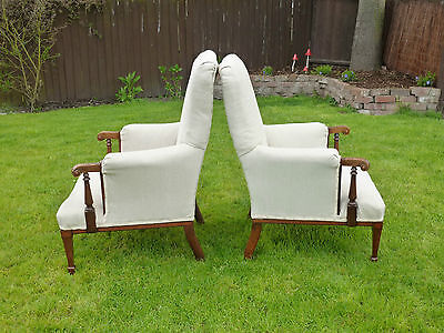 Pair antique Edwardian armchairs foliage carved arms reupholstered Laura Ashley