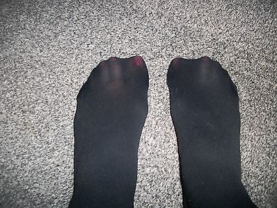 Black opaque tights worn large