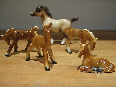 Set Of 4 Horse Figures And A Larger Horse