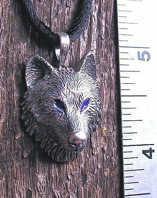Sterling Silver Timber Wolf Pendant With Blue Eyes