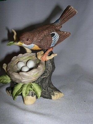Robin  Watching Her Nest / Eggs   Porcelain Figurine