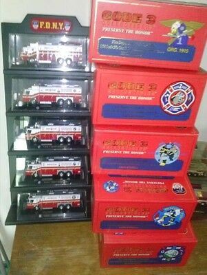 Lot of 5 1/64 FDNY E-One/Saulsbury Heavy Rescue 1-5 Trucks & Display Stand