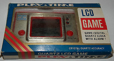 Vintage Lcd Arcade Trojans Play & Time Handheld Game & Clock/watch In Box/boxed
