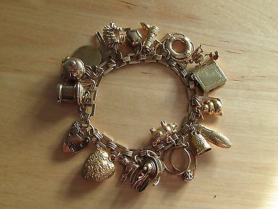 9ct gold square link charm bracelet with 21 charms