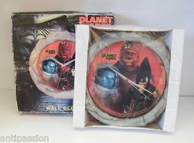 Planet of the Apes-Wall clock 2001 made in China en boite,et horloge sous cello.