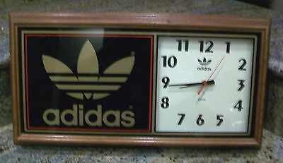 Vintage and Rare Classic Adidas Solid wood wall clock.