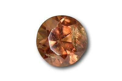 Grenat change couleur / vanadium naturel 0.92 carat, orange / vert