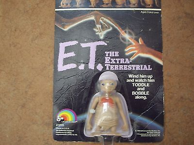 A 1982 Wind Up Toddle & Bobble Et Figure Unopened