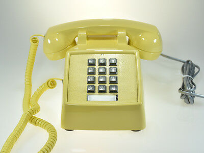 Vintage Old Classic Yellow Phone with Square Buttons and Handset