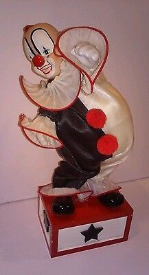 """Musical and Moving Clown on Wooden Box,  11"""" Tall (Price Products)"""