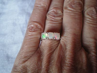 Ethiopian Opal trilogy ring, 1 carat, size N/O, in 1.64 grams of 925 Sterling Si