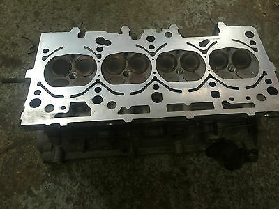 Audi A3 sport 2.0 fsi Cylinder head. skimmed and tested With valves BLX engine