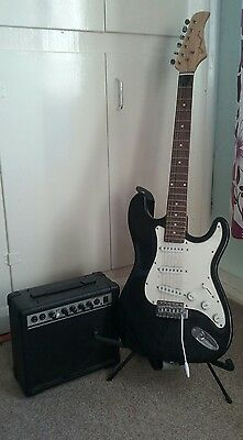 pitchmaster guitar, stand and amplifier