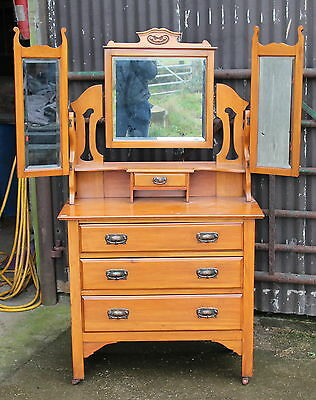 A Victorian Carved Satinwood Mirrored Dressing Table over Chest Part Suite