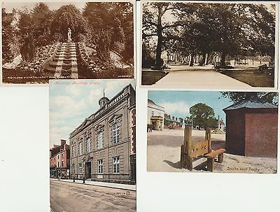 4 x early Rugby postcards Real Photo Parks, Village Stocks, STREET with building