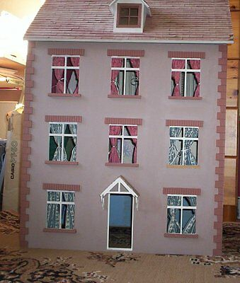 vintage 3 storey Doll House with some furniture.Local delivery at fuel cost