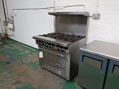 Six burner gas cooker with oven