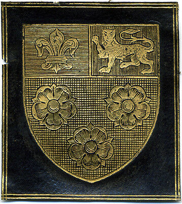 Eton College armorial book label on gold-tooled black leather