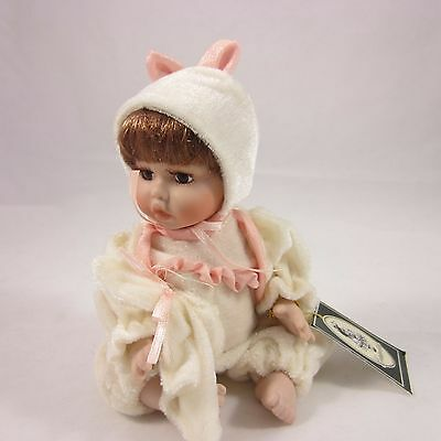 Geppeddo Bisque baby doll in bunny ears outfit