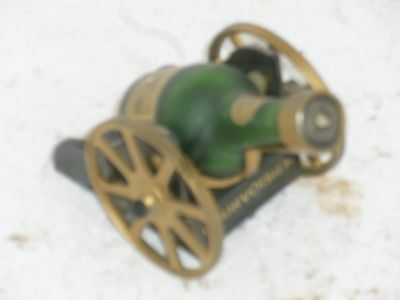 two courvoisier miniture cannons empty