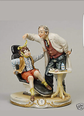 Capodimonte porcelain dentist with Scared baby