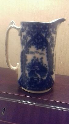 antique pottery blue and white Chelsea jug