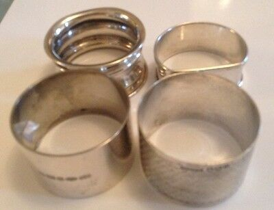 Four solid silver H/M Napkin Ring's