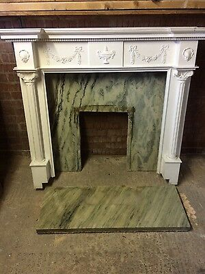 solid marble back/ hearth with wooden surround