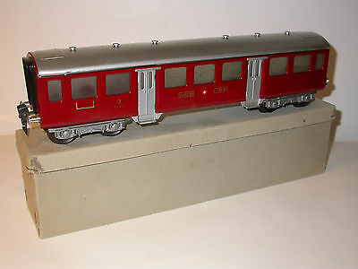Hag personwagen 157A. Scale 0.  Very unusual in the red color