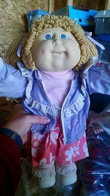 Vintage Cabbage Patch Kid Tan Hair and Blue eyes with 2 teeth 1986