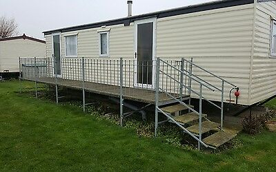 Caravan balcony with steps