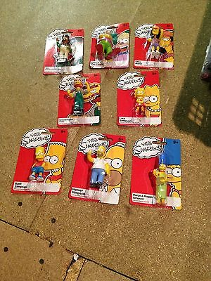 the simpsons action figures B.N.I.P / unopenned