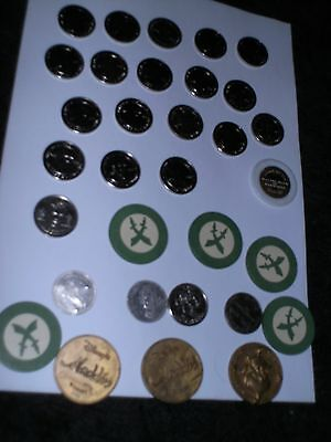 15 Coins ,Tokens 19 Millennium heroes , Aladdin Chips, other, plus Tobacco Tin .