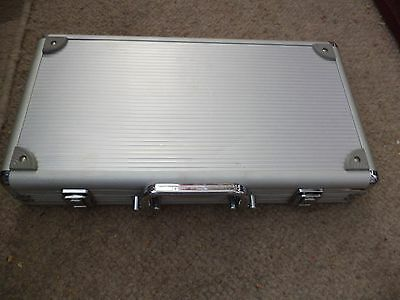 poker chips and dice contained in a metal carry case please see pictures