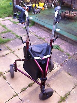 3 wheeled walker With Bag Has Signs Of Rust