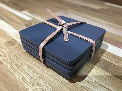 Set of 4 grey wooden coasters. Brand New