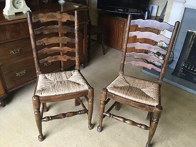 Two dining chairs in need of TLC