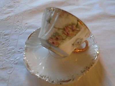 Antique Unsigned Flowers And Gold Trim Cup And Saucer.