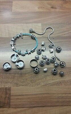 job lot of assorted jewellery items.rings. charms.