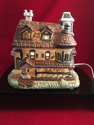 lighted ceramic haunted house